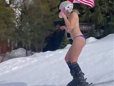 Chelsea Handler skiing topless with flags on her nipples