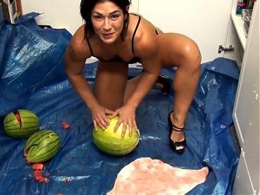 Strong girl breaking watermelon