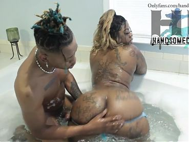Ebony stepmom and young stepson in bath