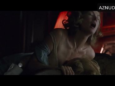 Rosamund Pike having sex on a couch